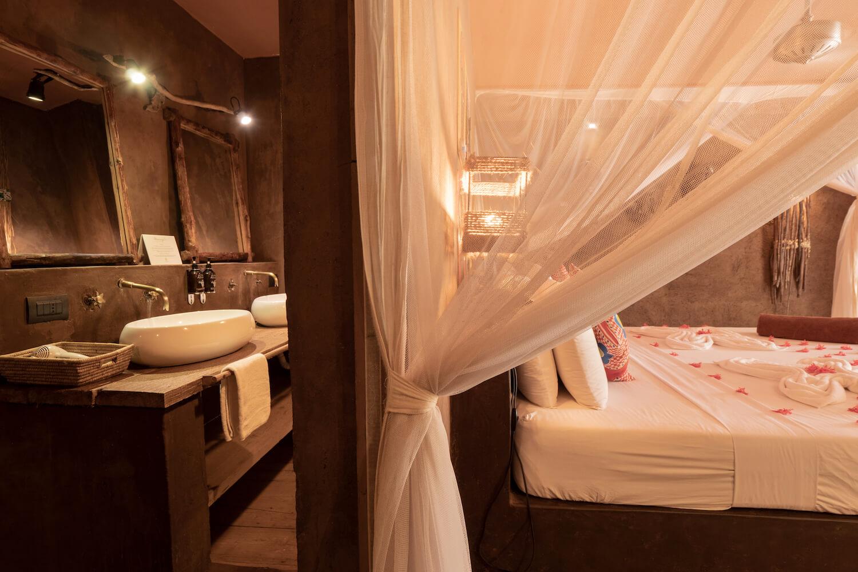 Mwezi Boutique Resort moon bungalow bedroom and bathroom