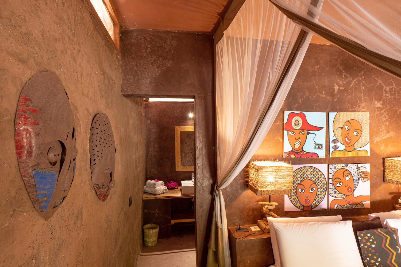 Mwezi Boutique Resort pool bungalow bedroom and bathroom