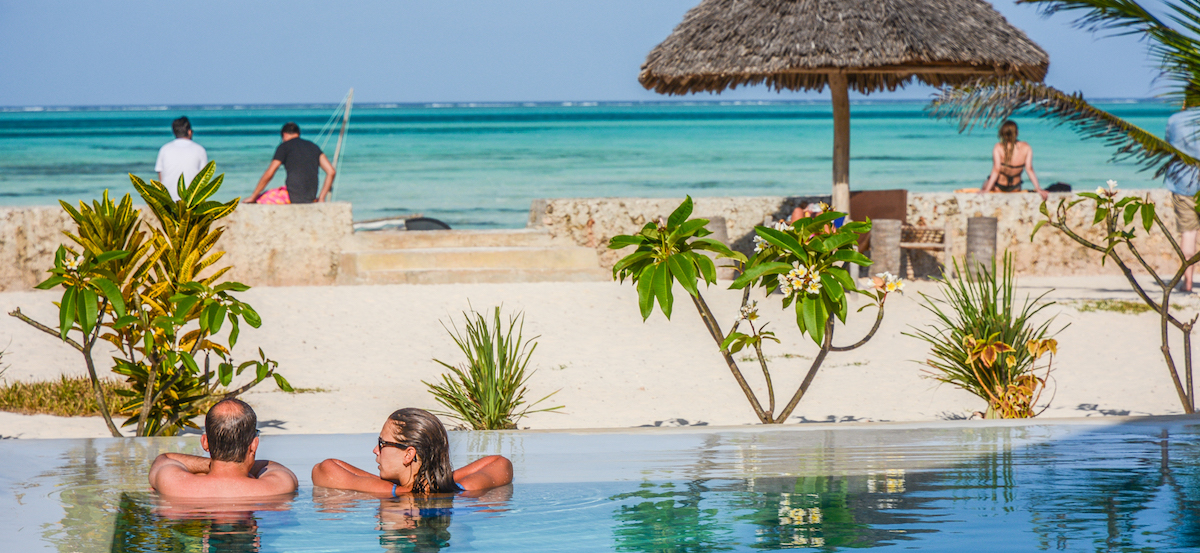 Nur Beach Resort pool, ocean view and private beach area with guests