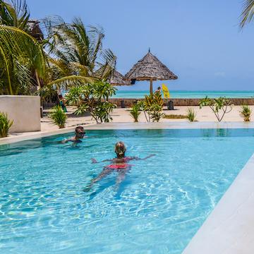 Nur Beach Resort pool with guest