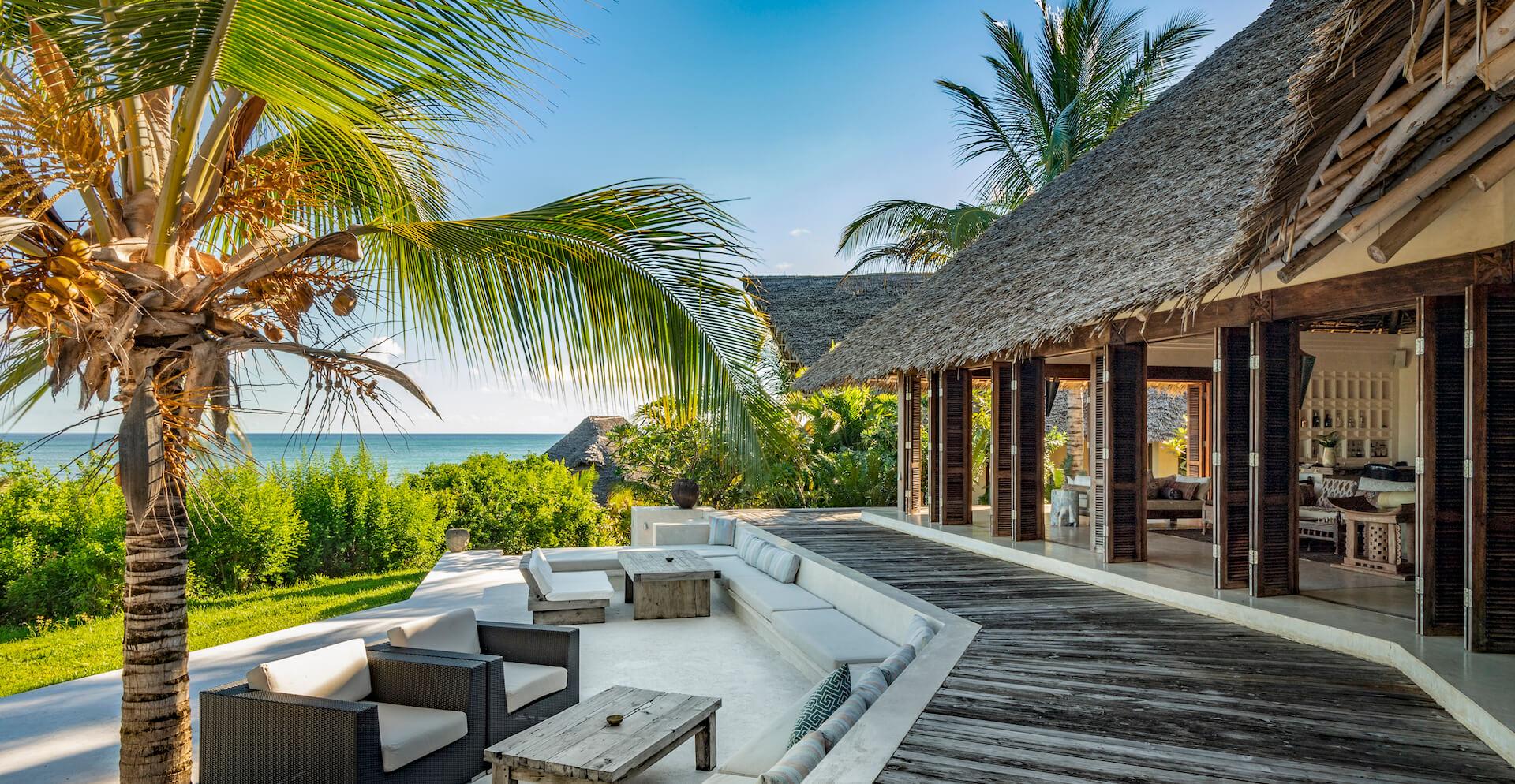 Qambani Luxury Resort terrace, living room and ocean view