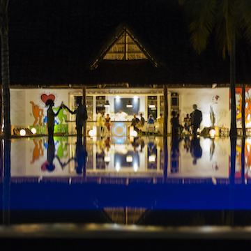 The Loop Beach Resort pool and bar night time