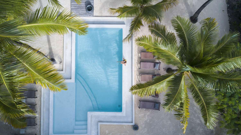 Uzuri Villa pool aerial with guest